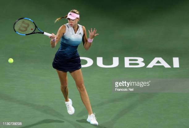 Kristina Mladenovic of France in action against Naomi Osaka of Japan during day three of the WTA Dubai Duty Free Tennis Championships at Dubai Tennis...