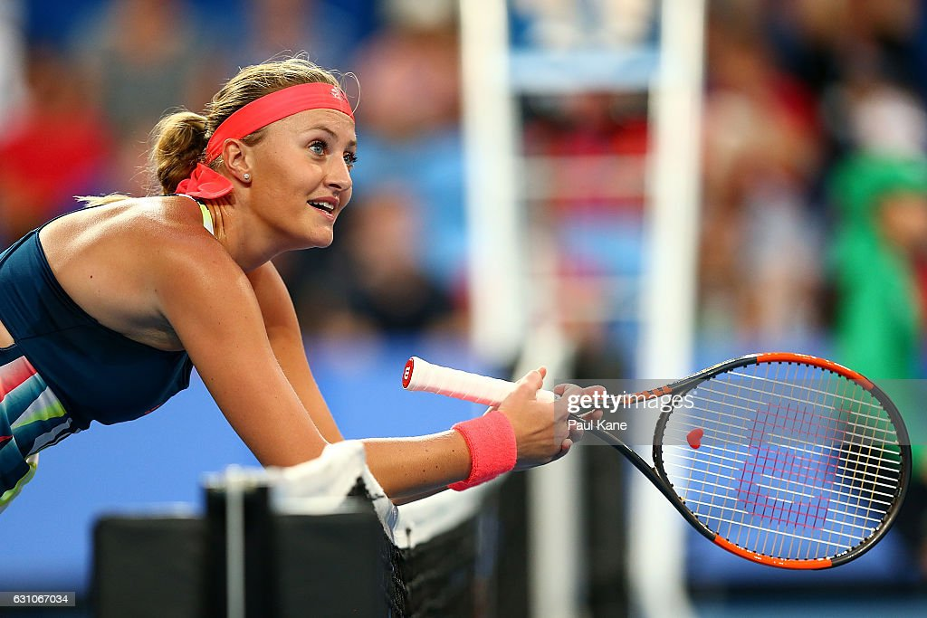 Kristina Mladenovic of France leans across the net after a shot to Belinda Bencic of Switzerland in the women's singles match during day six of the 2017 Hopman Cup at Perth Arena on January 6, 2017 in Perth, Australia.