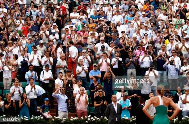 Kristina Mladenovic of France looks on to celebrates victory with the supporters following the lladies singles third round match against Shelby...