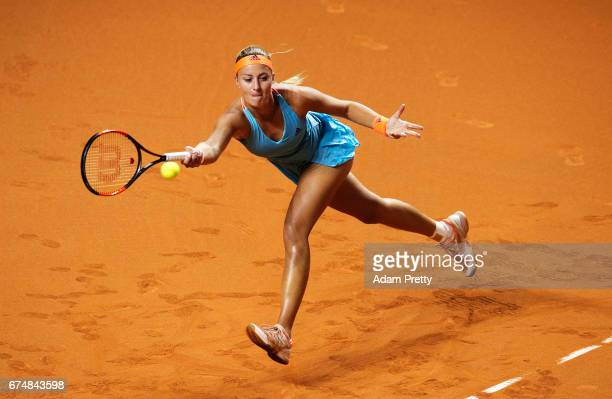 Kristina Mladenovic of France lunges for a forehand in her match against Maria Sharapova of Russia during the Porsche Tennis Grand Prix at Porsche...