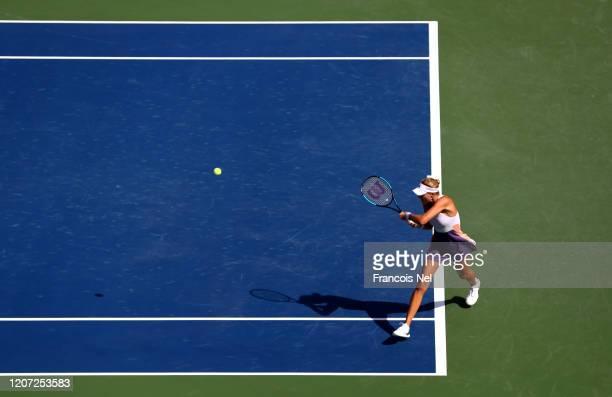Kristina Mladenovic of France plays a backhand against Karolina Pliskova of Czech Republic during Day Three of the Dubai Duty Free Tennis at Dubai...
