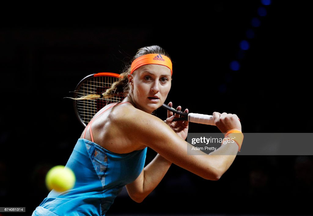 Kristina Mladenovic of France plays a backhand during her match against Angelique Kerber of Germany during the Porsche Tennis Grand Prix at Porsche Arena on April 27, 2017 in Stuttgart, Germany.