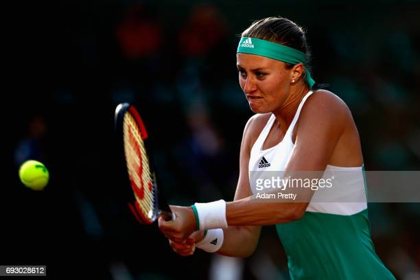 Kristina Mladenovic of France plays a backhand during ladies singles Quarter Finals match against Timea Bacsinszky of Switzerland on day ten of the...