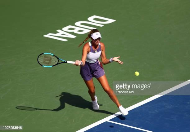 Kristina Mladenovic of France plays a forehand against Karolina Pliskova of Czech Republic during Day Three of the Dubai Duty Free Tennis at Dubai...