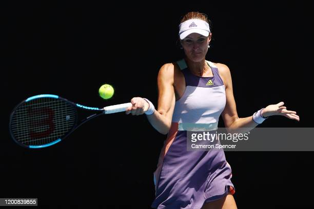 Kristina Mladenovic of France plays a forehand during her Women's Singles first round match against Karolina Pliskova of Czech Republic on day two of...