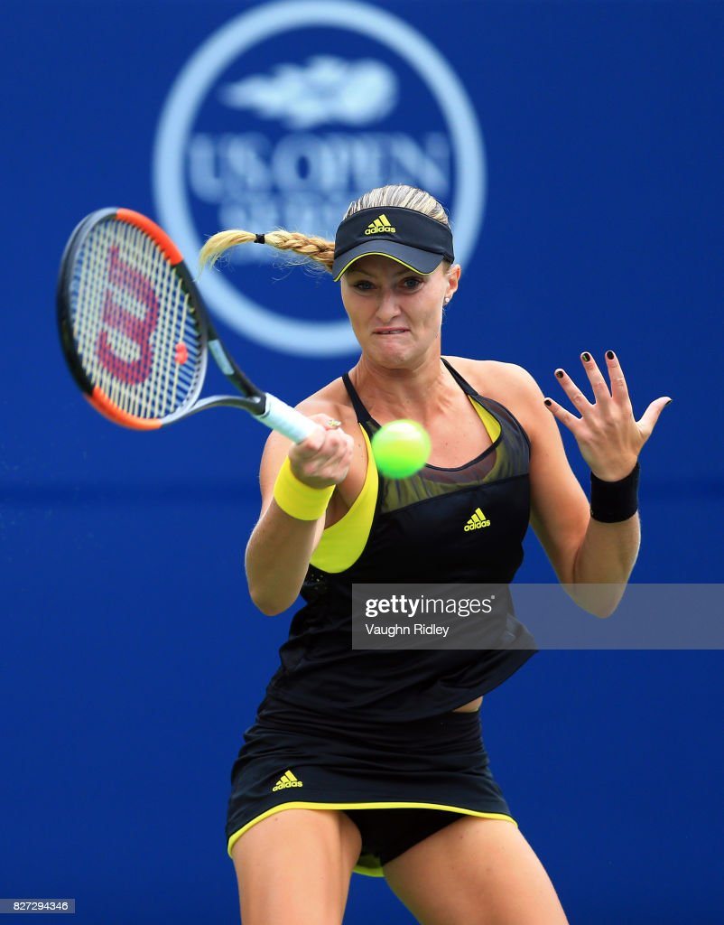 Kristina Mladenovic of France plays a shot against Barbora Strycova of Czech Republic during Day 3 of the Rogers Cup at Aviva Centre on August 7, 2017 in Toronto, Canada.