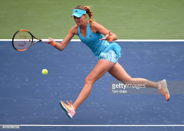 Kristina Mladenovic of France plays forehand during her match against Katerina Siniakova of Czech Republic on day two of the WTA Dubai Duty Free...