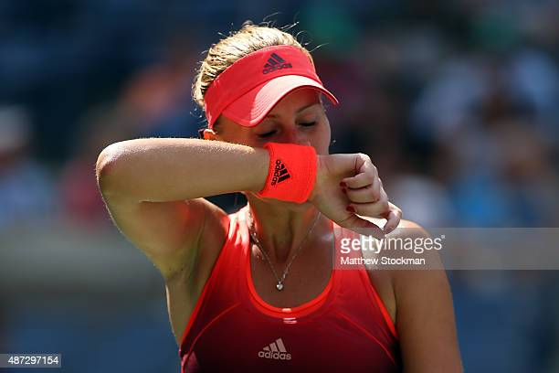 Kristina Mladenovic of France reacts against Roberta Vinci of Italy during their Women's Singles Quarterfinals Round match on Day Nine of the 2015 US...