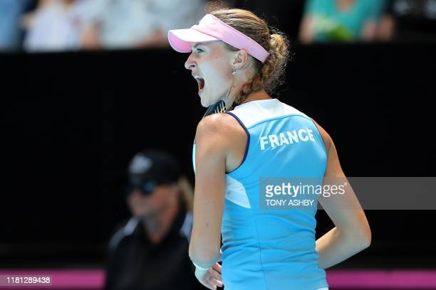 Kristina Mladenovic of France reacts on a point against Ashleigh Barty of Australia during the third rubber of the Fed Cup tennis final match between...