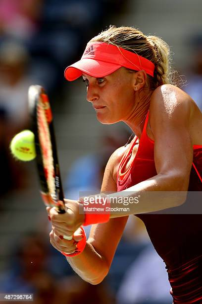 Kristina Mladenovic of France returns a shot to Roberta Vinci of Italy during their Women's Singles Quarterfinals Round match on Day Nine of the 2015...