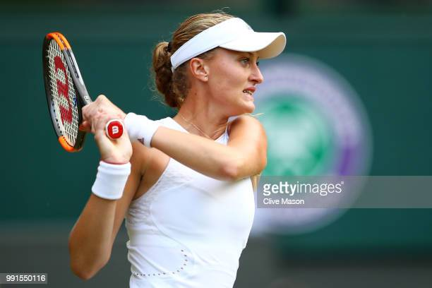 Kristina Mladenovic of France returns against Tatjana Maria of Germay during their Ladies' Singles second round match on day three of the Wimbledon...