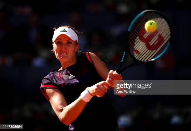 Kristina Mladenovic of France returns the bain her match against Karlolina Pliskova of the Czech Republic during day three of the Mutua Madrid Open...