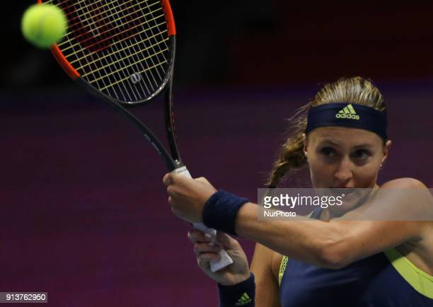 Kristina Mladenovic of France returns the ball to Daria Kasatkina of Russia during the St Petersburg Ladies Trophy ATP tennis tournament semi final...
