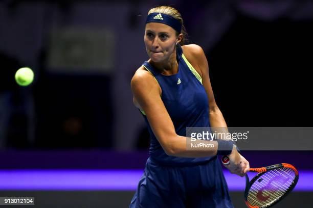 Kristina Mladenovic of France returns the ball to Dominika Cibulkova of Slovakia during the St Petersburg Ladies Trophy ATP tennis tournament match...
