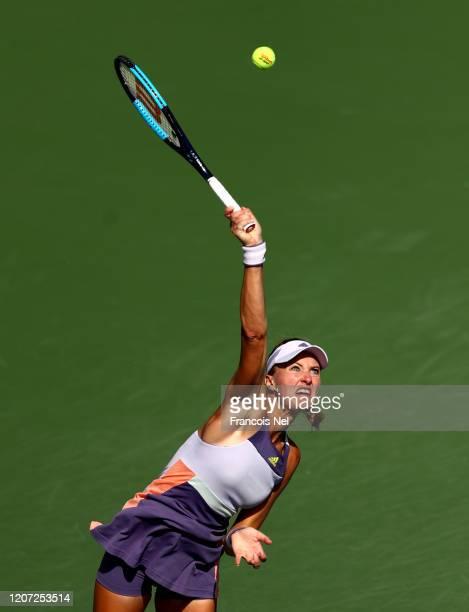 Kristina Mladenovic of France serves against Karolina Pliskova of Czech Republic during Day Three of the Dubai Duty Free Tennis at Dubai Duty Free...
