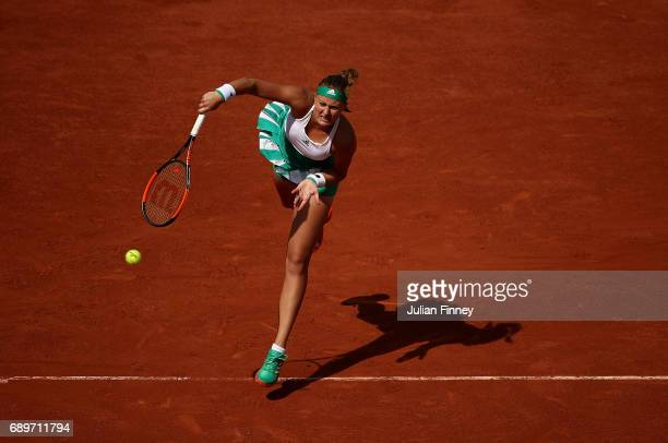 Kristina Mladenovic of France serves during the first round match against Jennifer Brady of The USA on day two of the 2017 French Open at Roland...