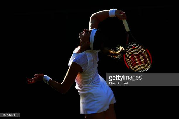Kristina Mladenovic of France serves during the Ladies Singles first round match against Pauline Parmentier of France on day two of the Wimbledon...