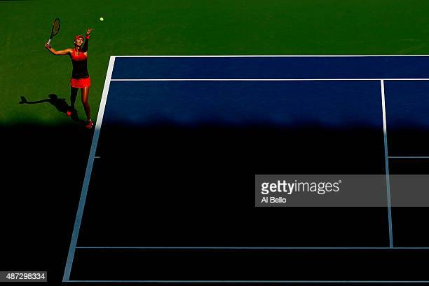Kristina Mladenovic of France serves to Roberta Vinci of Italy during their Women's Singles Quarterfinals Round match on Day Nine of the 2015 US Open...