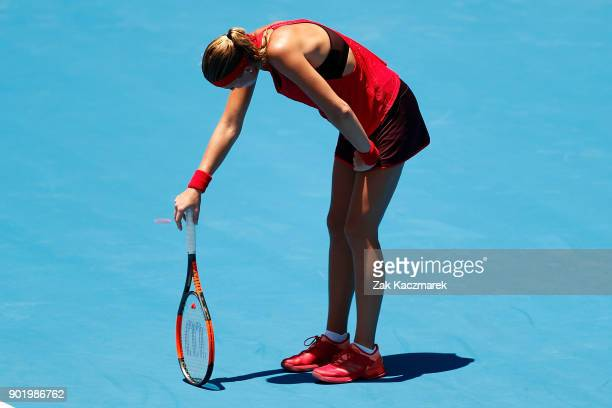 Kristina Mladenovic of France succumbs to the heat in her first round match against Ellen Perez of Australia during day one of the 2018 Sydney...