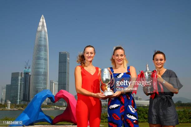 Kristina Mladenovic of France Timea Babos of Hungary and Ashleigh Barty of Australia pose with the Martina Navratilova trophy and Billie Jean King...