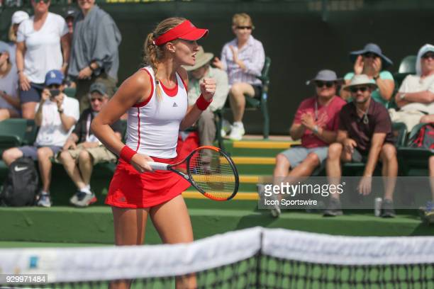 Kristina Mladenovic reacts after scoring a winning point against Samantha Stosur during the BNP Paribas Open on March 9 2018 at the Indian Wells...