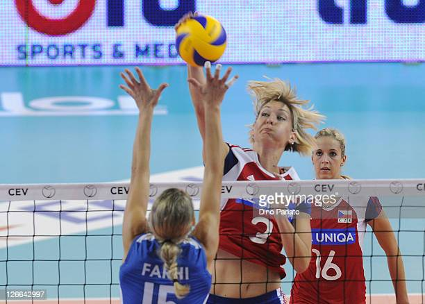 Kristina Pastulova of Czech Republic drops a shot against Anna Farhi of Israel during the Women's Volleyball European Championship match between...