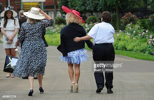 Kristina Rihanoff is escorted by security over dress code issues on Day 2 of Royal Ascot at Ascot Racecourse on June 18 2014 in Ascot England