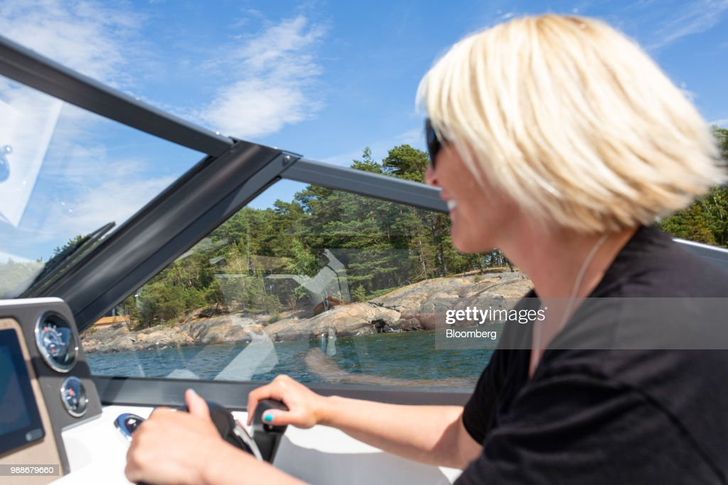 Kristina Roth, founder of the SuperShe network, drives a boat from SuperShe island near Raasepori, Finland, on Wednesday, June 27, 2018. The price of experimental networking on the island that has banned men, and only accepts heavily vetted women, is 4,000 euros, or $4,600. The package includes self-help tools that can lead participants down a different career path, as well as cognitive training to expel any negative thoughts. Photographer: Heli Blafield/Bloomberg via Getty Images