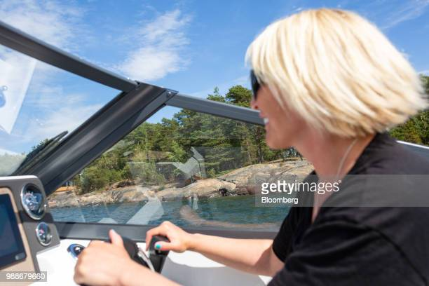 Kristina Roth, founder of the SuperShe network, drives a boat from SuperShe island near Raasepori, Finland, on Wednesday, June 27, 2018. The price of...