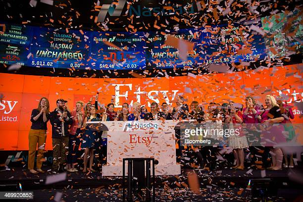 Kristina Salen chief financial officer of Etsy Inc center left and Chad Dickerson chief executive officer of Etsy center right applaud as they open...