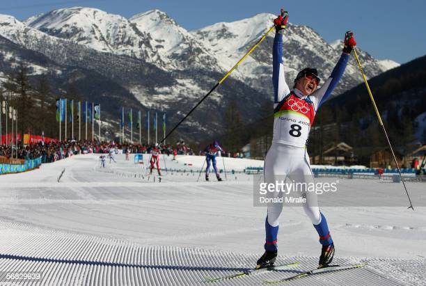 Kristina Smigun of Estonia celebrates winning the Gold Medal after winning the Womens Cross Country Skiing 15km Pursuit Final on Day 2 of the 2006...
