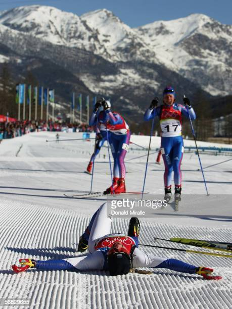 Kristina Smigun of Estonia lies on her back and celebrates winning the Gold Medal after winning the Womens Cross Country Skiing 15km Pursuit Final on...