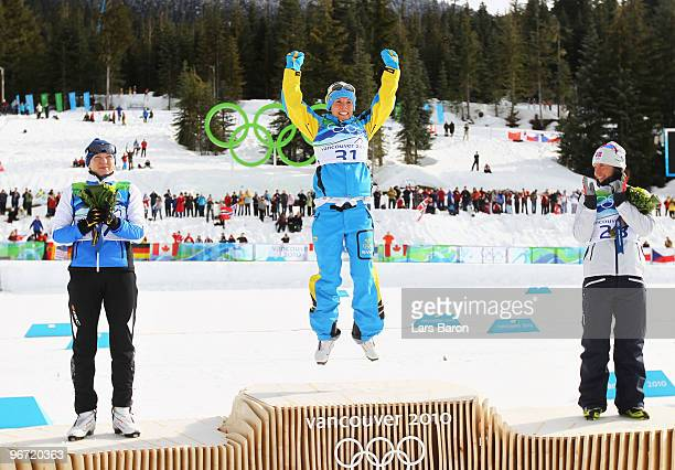 Kristina SmigunVaehi of Estonia wins the silver medal Charlotte Kalla of Sweden wins the gold medal and Marit Bjoergen of Norway wins the bronze...