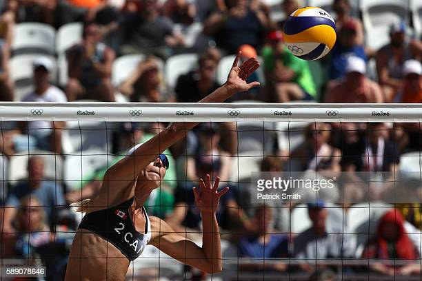 Kristina Valjas of Canada spikes the ball during a Women's Round of 16 match between Canada and Canada on Day 8 of the Rio 2016 Olympic Games at the...