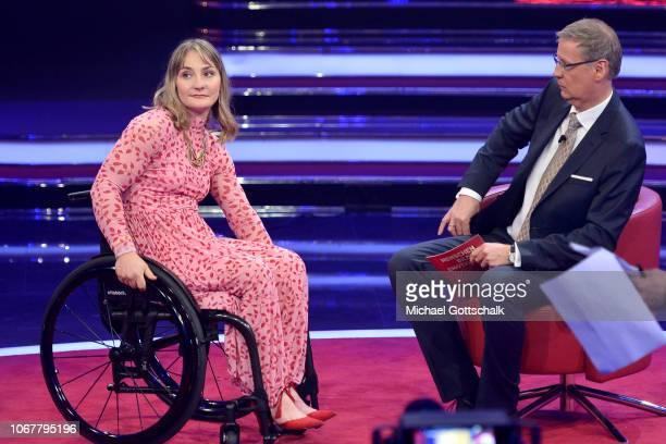 Kristina Vogel and Günther Jauch speak on stage during the tv show '2018 Menschen Bilder Emotionen' on December 3 2017 in Cologne Germany