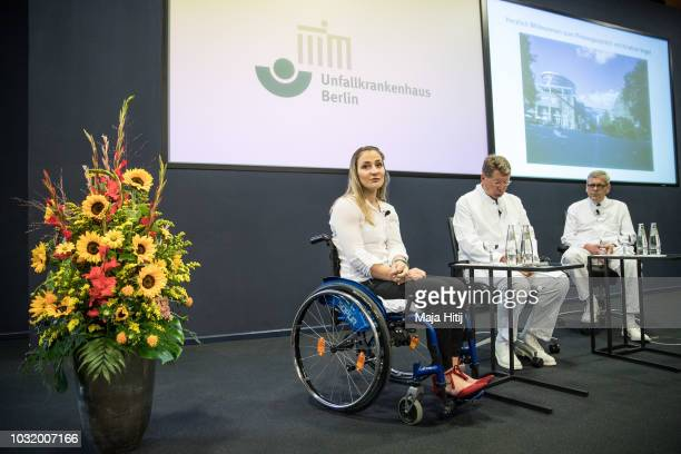 Kristina Vogel Track Cycling Olympic Gold Medalist speaks at a press conference at Accident Hospital on September 12 2018 in Berlin Germany next to...