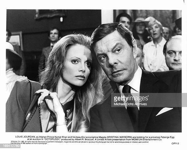 Kristina Wayborn and Louis Jourdan bidding for a priceless Faberge egg in a scene from the film 'Octopussy' 1983