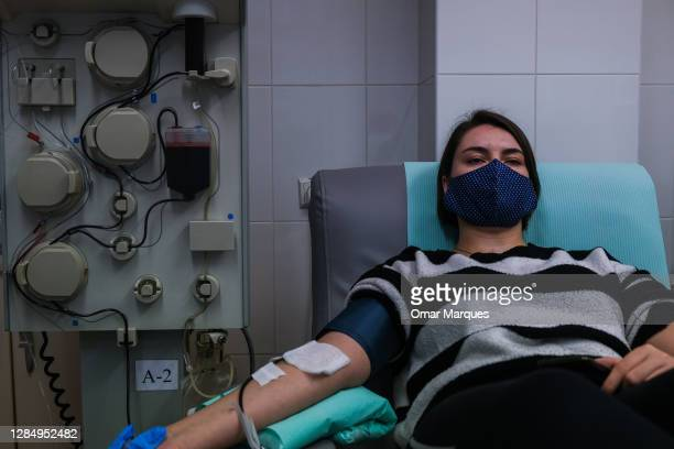 Kristina, who recovered from COVID -19 donates her plasma via plasmapheresis method at the Regional Center of Blood Donation and Blood Treatment on...