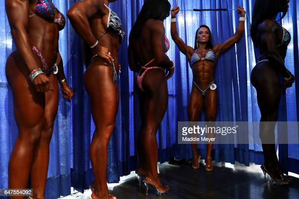 Kristine Duba second from right warms up backstage before the Fitness International competition prejudging at the Greater Columbus Convention Center...