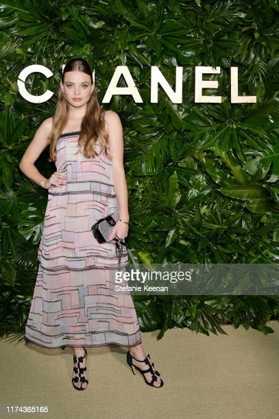 Kristine Froseth wearing CHANEL attends Chanel Dinner Celebrating Gabrielle Chanel Essence With Margot Robbie on September 12 2019 in Los Angeles...