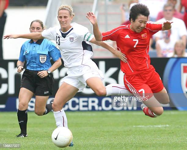 Kristine Lilly of the United States knocks Yan Bi of China off the ball as the US Women's National Team crushed arch rivals People's Republic of...