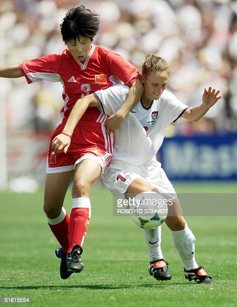 Kristine Lilly of the US keeps Fan Yunjie of China away from the ball during regulation time of their finals game of the Women's World Cup soccer...
