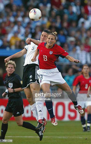 Kristine Lilly of the USA and Birgit Prinz of Germany jump for a header during the semifinals of the FIFA Women's World Cup match on October 5 2003...