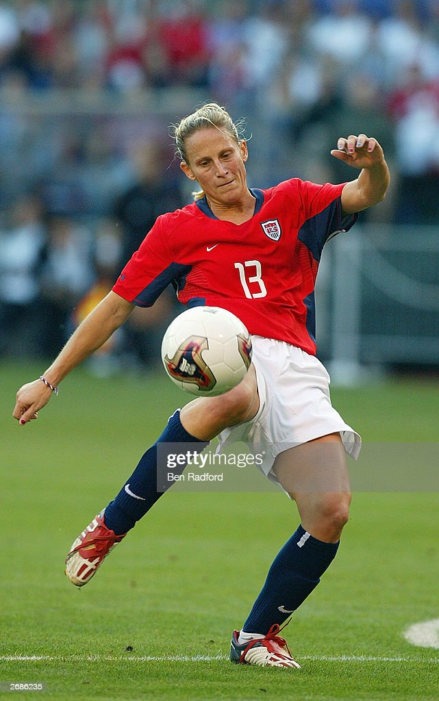 Kristine Lilly #13 of the USA sets to kick the ball against Germany during the semifinals of the FIFA Women's World Cup match on October 5, 2003 at PGE Park in Portland, Oregon. Germany defeated the U