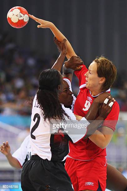 Kristine Lunde of Norway is tackled by Maria Teresa Neto Joaquim Eduardoi and Elizabeth Amelia Basilio Viegas of Angola during the Women's Handball...