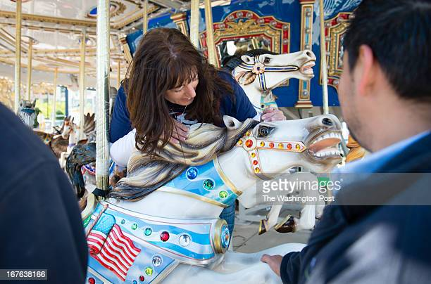 Kristine Smutek Carousel manager for the National Harbor hugs one of the horses after it was installed She owns a real horse National Harbor is...