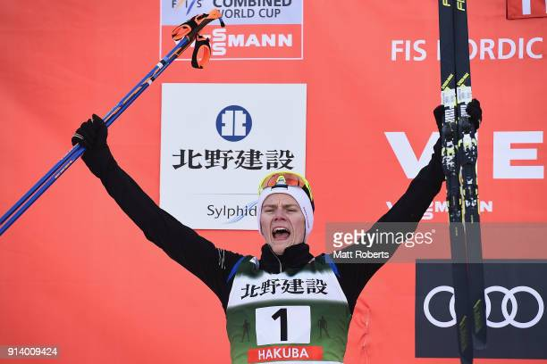 Kristjan Ilves of Estonia celebrates on the podium after placing second in the Individual Gundersen LH/10km during day two of the FIS Nordic Combined...