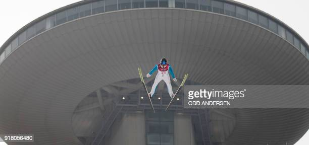 Kristjan Ilves of Estonia competes in the nordic combined men's individual NH/10km jumping trial round at the Alpensia ski jump centre during the...