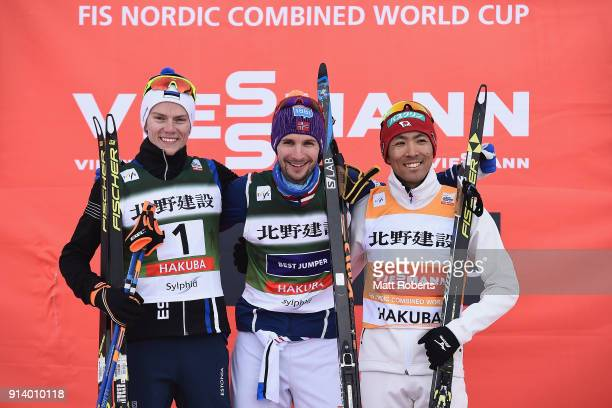 Kristjan Ilves of Estonia Jan Schmid of Norway and Akito Watabe of Japan pose for a photo on the podium after the Individual Gundersen LH/10km during...