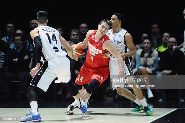 Kristjan Kangur of Openjobmetis competes with Valerio Mazzola and Abdul Gaddy of Obiettivo Lavoro during the LegaBasket match between Virtus...